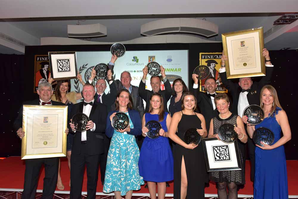 winners of the art & framing industry awards 2019 with their handmade glass plates
